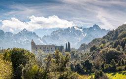 San Francesco convent and mountains at Castifao in Corsica. Ruin of San Francesco convent in the village of Castifao in Corsica set against snow covered Royalty Free Stock Photo