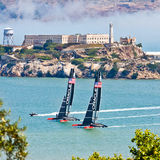 San Francisco Americas Cup Team Oracle Alcatraz. Two multi-million dollar Americas Cup Team Oracle sailboats practice in front of famous Alcatraz Island in San Stock Photos