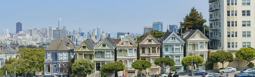 The famous Painted Ladies. San Francisco, AUG 18: Afternoon view of the famous Painted Ladies with downtown building on AUG 18, 2018 at San Francisco, California stock image