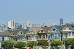 The famous Painted Ladies. San Francisco, AUG 18: Afternoon view of the famous Painted Ladies with downtown building on AUG 18, 2018 at San Francisco, California royalty free stock image