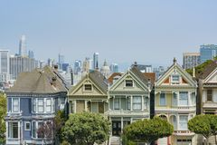 The famous Painted Ladies. San Francisco, AUG 18: Afternoon view of the famous Painted Ladies with downtown building on AUG 18, 2018 at San Francisco, California royalty free stock photo