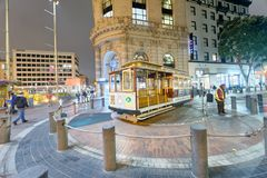 SAN FRANCISCO - AUGUST 7, 2017: Antique Cable Car on Powell Stre. Et Turntable as the car is turned around at night. It is a major city attraction Royalty Free Stock Photo