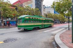 SAN FRANCISCO - AUGUST 6, 2017: Colorful cable car speeds up alo Stock Photography