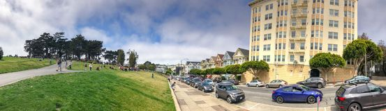 SAN FRANCISCO - AUGUST 5, 2017: Tourists enjoy Painted Ladies vi. Ew. The city attracts 25 million people annually Royalty Free Stock Images