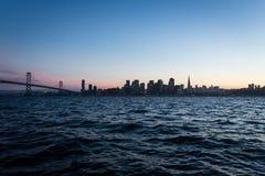 San Francisco Bay Bridge and city lights at night Stock Photo