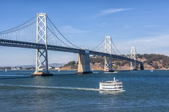 San Francisco Bay Bridge and Ferry. Cruising on San Francisco Bay. Bridge bridge and Ferry in background Royalty Free Stock Photo