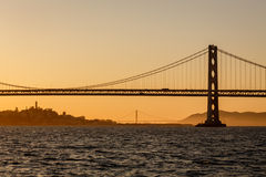 San Francisco Bay Bridge and Golden Gate bridge at sunset Stock Photos