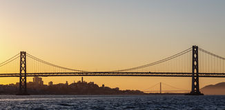 San Francisco Bay Bridge and Golden Gate bridge at sunset Royalty Free Stock Photography