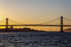 San Francisco Bay Bridge and Golden Gate bridge at sunset Stock Image