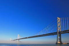 San Francisco Bay Bridge Misted Over Royalty Free Stock Photos