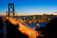 San Francisco and Bay Bridge at night. With Christmas lights around the buildings Stock Photography