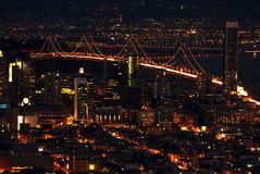 San francisco bay bridge at night. San francisco bay bridge lit at night, with financial district Stock Photography