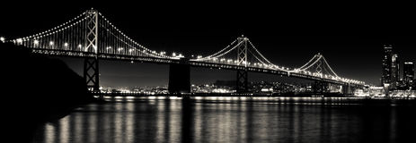 San Francisco Bay Bridge at Night Black and White. A black and white evening shot of the glowing Bay Bridge in San Francisco from Treasure Island in San Stock Photos