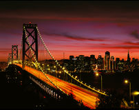 San Francisco Bay Bridge at Night. And city skyline Royalty Free Stock Images