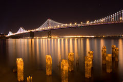 San Francisco Bay Bridge at night. Lit up with white lights Stock Photos