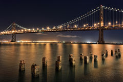 San Francisco Bay Bridge at Night Panorama.  Stock Photos