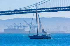 San Francisco Bay bridge sailboat from Pier 7 California Stock Images