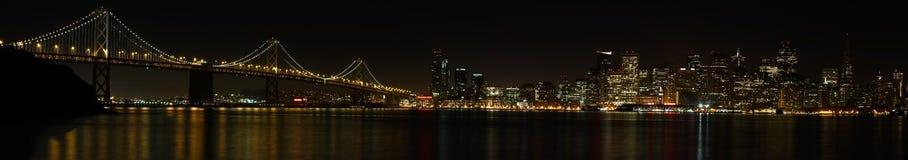 San Francisco Bay Bridge and Skyline at Night Stock Images
