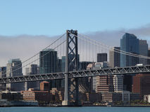 San Francisco Bay Bridge Tower with City Skyline Royalty Free Stock Image