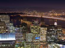 San Francisco and the Bay Bridge at Twilight. The southern end of downtown San Francisco, the bay, and the Bay Bridge at night from above Stock Photo