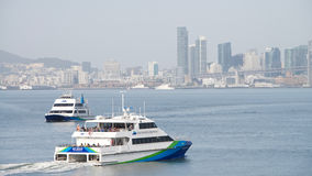 San Francisco Bay Ferry vessels BAY BREEZE and ENCINAL passing stock image