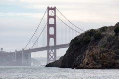 San Francisco Bay Golden Gate Bridge suspension tower. Golden Gate Bridge and fisherman on cliffs Royalty Free Stock Image