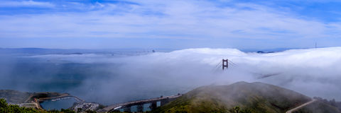 San Francisco Bay panorama. And the fog layered over the Golden Gate Bridge (seen from Slacker Hill Stock Image