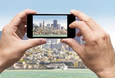 San Francisco bay taking picture smartphone royalty free stock photos