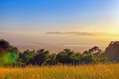 San francisco bay view on mountain in sunset ,San francisco,California,USA. San francisco bay view on mountain in sunset and fog cover,San francisco,California royalty free stock photo