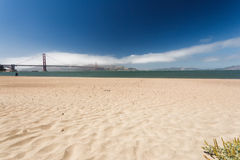 San Francisco beach with distant view of Golden Gate Bridge stock image