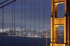 San Francisco through the Bridge. San Francisco at night through the Golden Gate Bridge Stock Photos