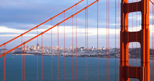 San Francisco through the Bridge. San Francisco sunset panorama through the Golden Gate Bridge Stock Image