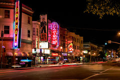 San Francisco - Broadway Street Strip Clubs at Night. A vivid red light district nighttime view of the Condor Topless A Go-Go club, along with Big Als and Royalty Free Stock Photo