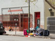 Homeless and drug users line up outside Tenderloin Housing Clinic royalty free stock photography