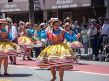 Women showing off spin dance moves wearing Mexican fiesta dresse royalty free stock image