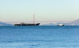 Morro Bay barge. San Francisco, CA - December 31, 2015: Sause Bros ship the Morro Bay being towed out of, San Francisco the morning of December 31, 2015 Stock Photos