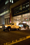 SAN FRANCISCO, CA - JANUARY 27, 2015: A tow truck pulls an SUV from the smashed front window of a Wells Fargo ban Stock Image