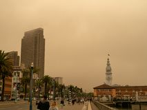 San Francisco Ferry Building on Embarcadero taken over by smog of nearby wildfires stock images