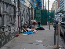 Homeless people gather on the streets of San Francisco. SAN FRANCISCO, CA - MARCH 23, 2018: Homeless people gather on the streets of San Francisco. Finding royalty free stock photo