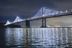 Illuminated Bay Bridge in San Francisco. The Bay Lights is an iconic light sculpture designed by artist Leo Villareal stock photography