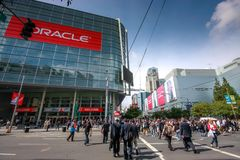 Attendees of Oracle Open World conference go to  Moscone Center. SAN FRANCISCO, CA, USA - OCT 4, 2011: Attendees of Oracle Open World conference go to  Moscone Stock Photo
