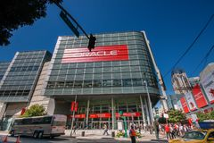 Attendees of Oracle OpenWorld conference go to Moscone Center West. SAN FRANCISCO, CA, USA - OCT 2, 2012: Attendees of Oracle Open World conference go to Royalty Free Stock Photos
