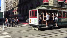 World famous cable car moving in San Francisco. San Francisco, CA, USA, october 2016: the world famous cable car moving with tourists along the streets of Union stock video