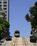 San Francisco Cable Car. Powel Street cable car going over the top of a hill Royalty Free Stock Images