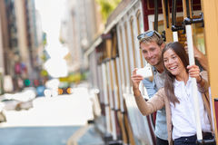 San Francisco cable car couple taking phone selfie royalty free stock photography