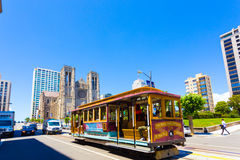 San Francisco Cable Car Grace Cathedral H. San Francisco, USA - May 20, 2016: Cable car rolls down California Street in front of Grace Cathedral on top of Nob Royalty Free Stock Images