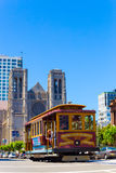 San Francisco Cable Car Grace Cathedral Hob Hill V. San Francisco, USA - May 20, 2016: Cable car passing down California Street in front of Grace Cathedral on Royalty Free Stock Photo