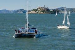 Catamaran an Sail Boats at San Francisco Bay on Alcatraz Island background royalty free stock photos