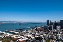 SAN FRANCISCO, CALIFORNIA - SEPTEMBER 9, 2015 - View of the Embarcadero area and Oakland Bay Bridge from Coit Tower.  stock photo