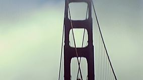 Drive through Golden Gate. San Francisco, California, United States - in 1980: Archival eighties footage, point of view of vintage car crossing Golden Gate stock video footage